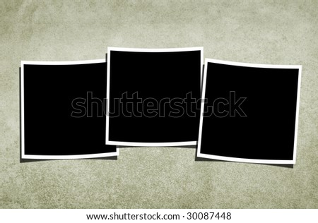 Three blank photographs over vintage textured background. - stock photo