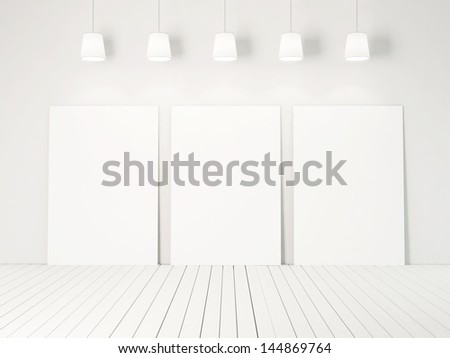 three blank posters and white wall - stock photo