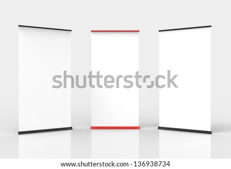 Three blank roll-up poster banner displays