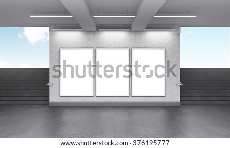 Three blank vertical billboard in the underground crossing, stairs up on both sides, blue sky seen from the street. Grey walls. Front view. Concept of underground advertising. 3D rendering