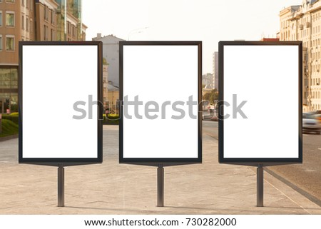 Three blank vertical street billboard posters on city background. 3d illustration.
