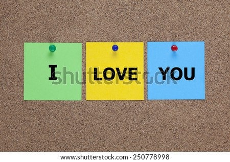Three blanks post-it notes on cork board with words �«I love you�». - stock photo