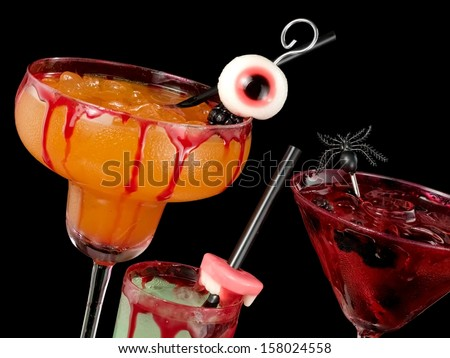 Three bloody Halloween cocktails, close up - stock photo