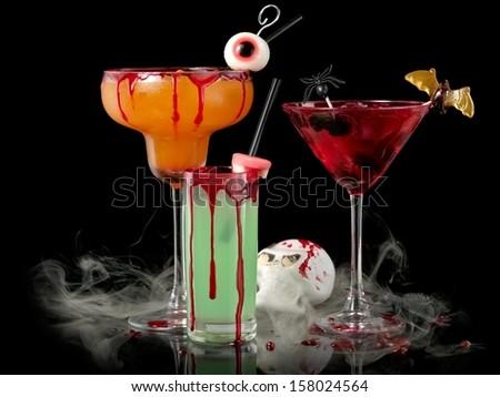 Three bloody Halloween cocktails in smoke - stock photo