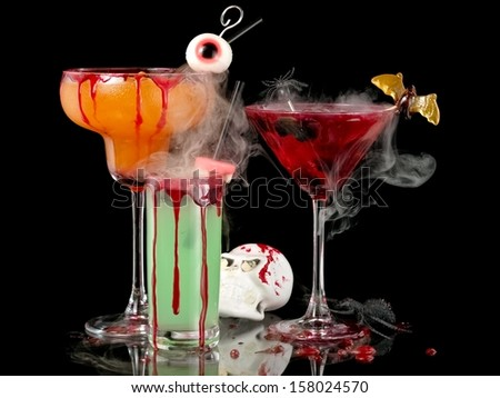 Three bloody Halloween cocktails with smoke - stock photo