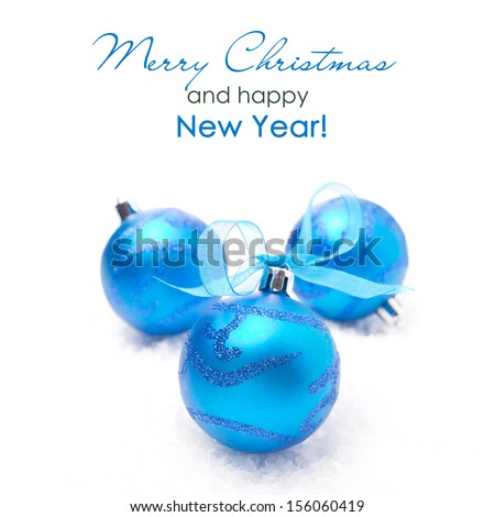 three blue Christmas balls, isolated on white background, close-up