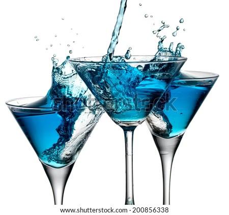 Three blue cocktails splash - stock photo