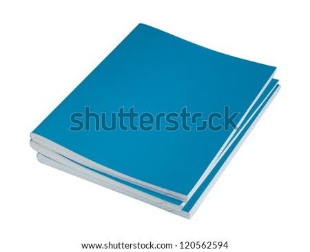 Three blue copybooks on a white background - stock photo