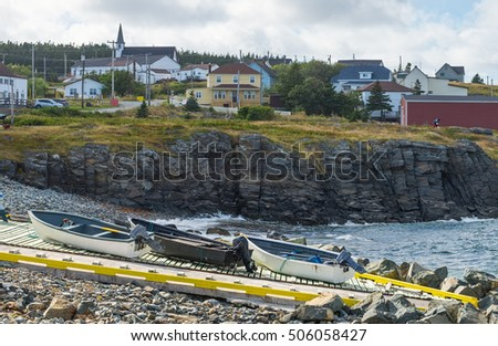 Three boats on a launch ramp