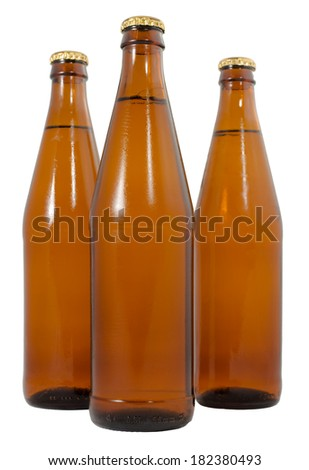 Three bottles of cold beer beer isolated on a white background