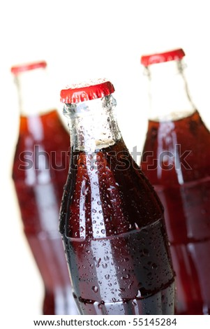 Three bottles of cold cola with water drops. Closeup, small DOF - stock photo