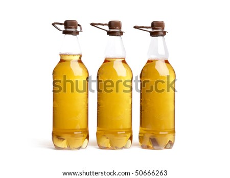 Three bottles of light beer on a white background