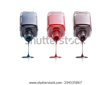 three bottles of nail polish flow on white background