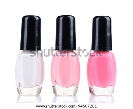 three bottles of nail polish isolated on white - stock photo