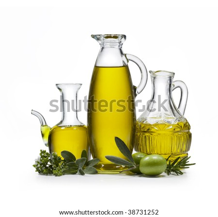 Three bottles of olive oil with two olives and spices on white background - stock photo