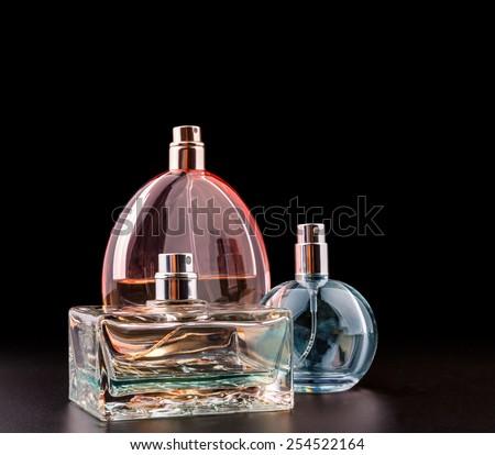 Three bottles of perfumes - stock photo