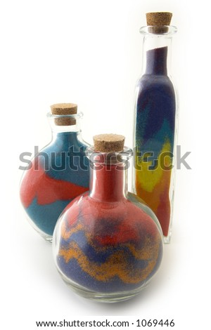 Three bottles with colorful sand - stock photo