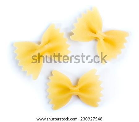 Three bow tie of farfalle pasta on white background - stock photo
