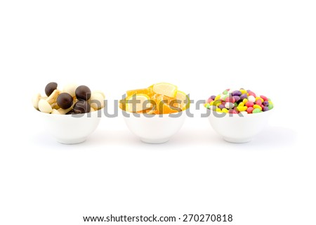 Three bowls of sweets and chocolate jelly mushrooms isolated