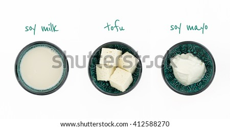 Three bowls with soy milk, tofu and soy mayo,  isolated on white, with text. - stock photo