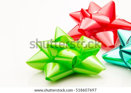 Three bows for presents on a white background.