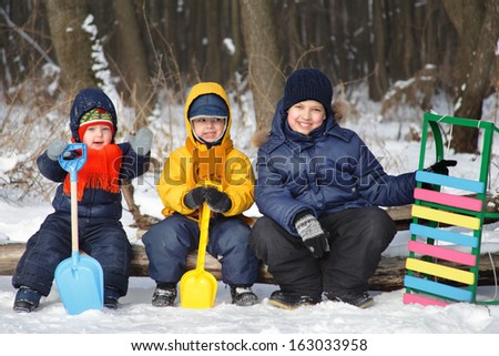 three boy play on snow - stock photo
