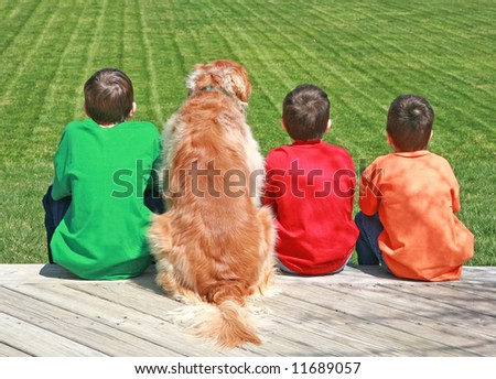 Three Boys and a Dog - stock photo