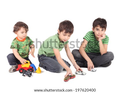 three boys with toy cars - stock photo