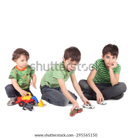 three boys with toy cars - stock photo