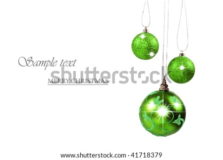 Three bright green christmas baubles against white background with space for text