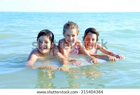 three brothers in the middle of the sea with the surf Tablet