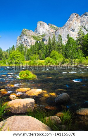 Three Brothers Rock with Merced River in Yosemite National Park, California - stock photo