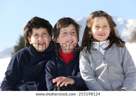 three brothers smile in snow mountain in winter - stock photo