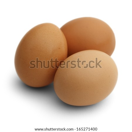 Three Brown Chicken Eggs Isolated on White Background. - stock photo