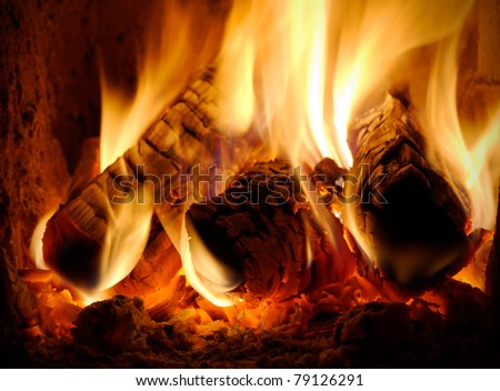 three burning billets in hot stove - stock photo