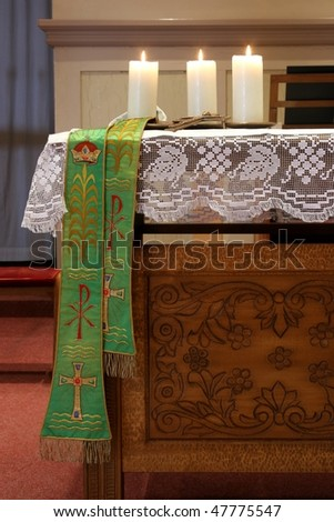 Three burning candles on church altar - stock photo