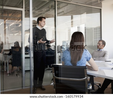 Three business people discussing during business meeting - stock photo