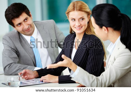 Three business people discussing new project in office - stock photo