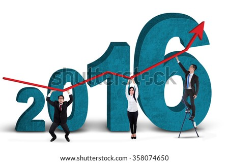 Three business people holding upward arrow together with numbers 2016, isolated on white background - stock photo