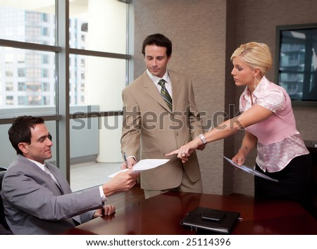 Three business people in a meeting - stock photo