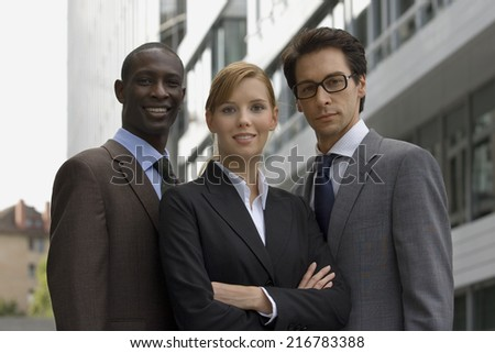 Three business people standing together.