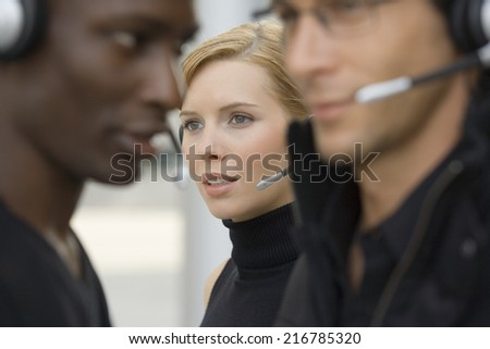 Three business people standing together. - stock photo