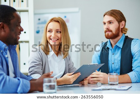 Three business people talking - stock photo