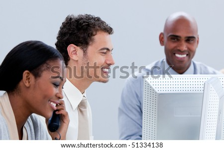 Three business people working in the office in a company