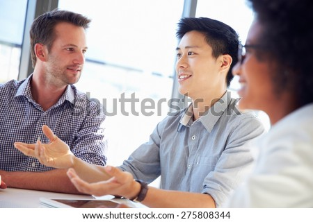 Three business professionals working together - stock photo