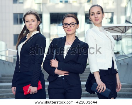 Three business women - business team. Teamwork. Businesswomen discussing. Group of business people. - stock photo