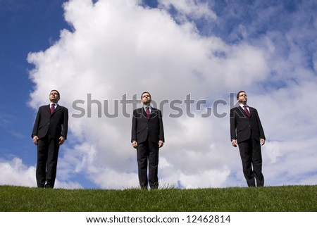 three businessman standing at the top of the hill