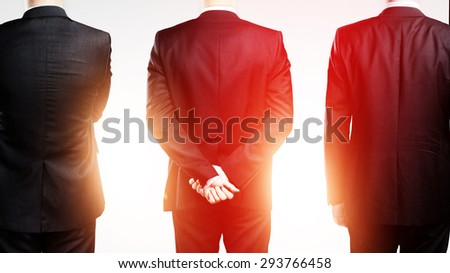 three businessman standing back on a white background