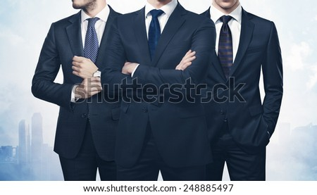 Three businessmen on megalopolis background