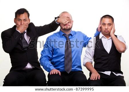 Three businessmen - Three wise moneys. See no evil, hear no evil, speak no evil - stock photo